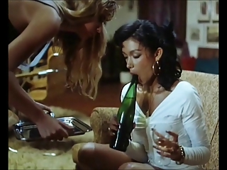 Girls lesbian play with the bottle of champagne